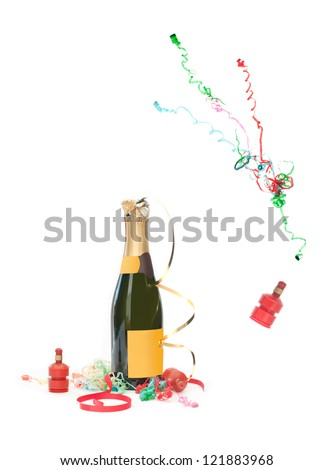Champagne bottle and party streamer popping - stock photo