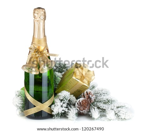 Champagne bottle, christmas gift and snowy firtree. Isolated on white background - stock photo