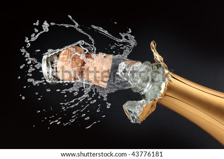 Champagne bottle cork popping - stock photo