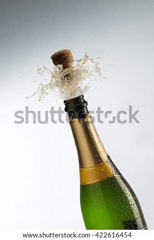 Champagne bottle getting uncorked