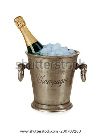 Champagne bottle in a bucket with ice isolated on the white - stock photo