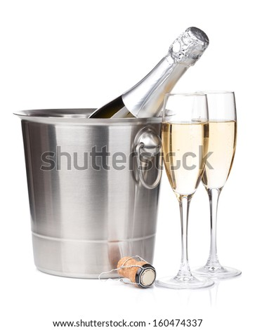 Champagne bottle in bucket and two glasses. Isolated on white background