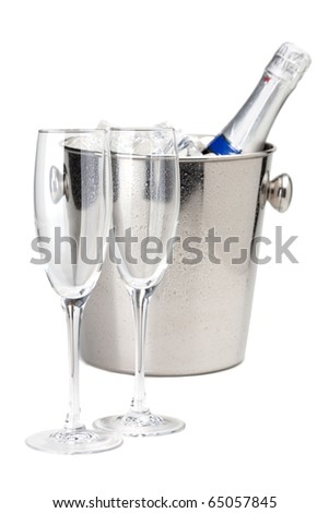 Champagne bottle in cold ice bucket and two empty glasses. Isolated on white - stock photo