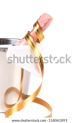 Champagne bottle in cooler and paper streamer