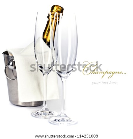 Champagne bottle in cooler and two champagne glasses (with easy removable sample text) - stock photo