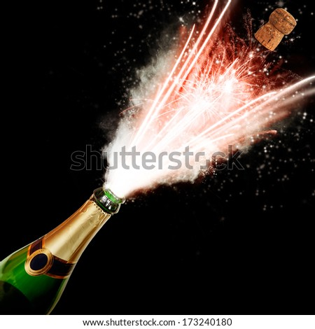 Champagne bottle with blasting fire, isolated on black background - stock photo