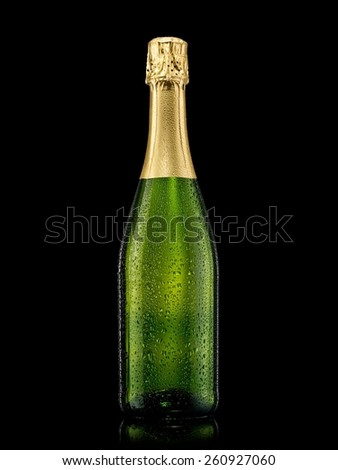 Champagne bottle with drops on black background - stock photo