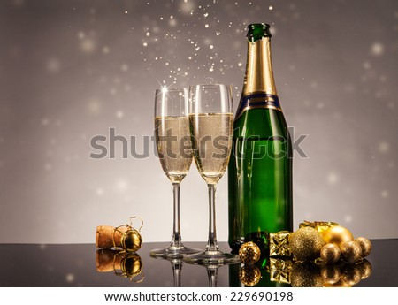 Champagne bottle with glasses. Celebration theme with champagne still life - stock photo