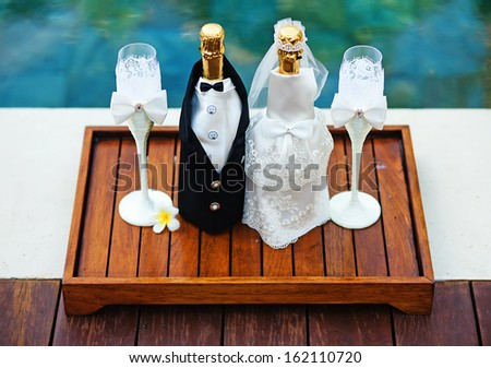 champagne bottles decoration for wedding day - stock photo