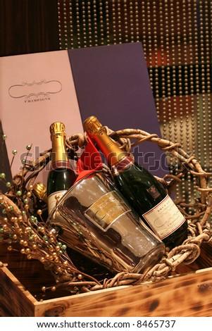 Champagne bottles in basket - stock photo