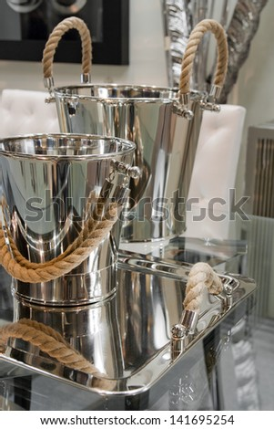 champagne bucket and tray on table - stock photo