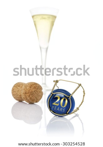 Champagne cap with the inscription 20 years - stock photo