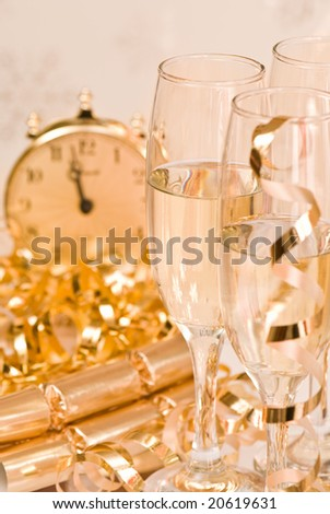 Champagne celebration for New Year or significant event, gold tones - stock photo