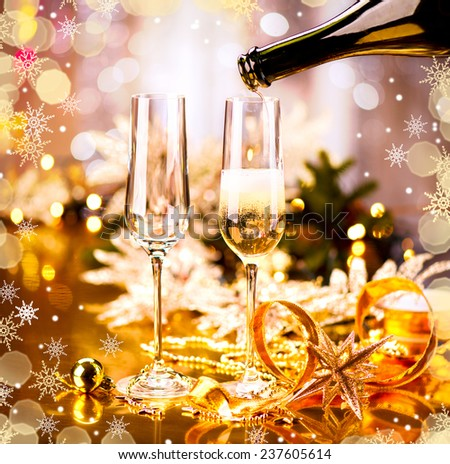 Champagne Christmas and New Year celebration. New Year holiday decorated table. Two Champagne Glasses