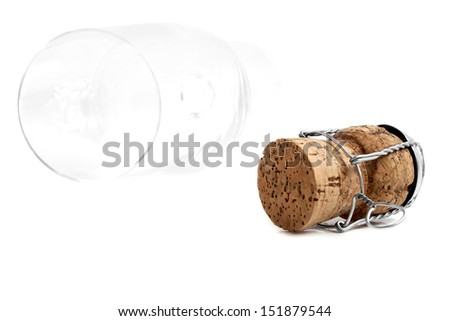 Champagne cork and champagne glass on a white background - stock photo