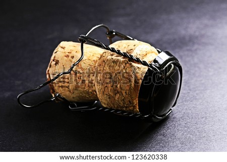 Champagne cork on a black. - stock photo