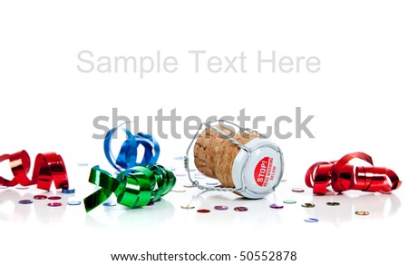 champagne cork on a white background with red, blue and green streamers and confetti and copy space - stock photo