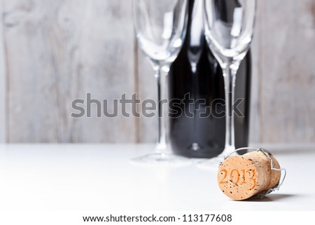 Champagne cork with background glass and bottle - stock photo