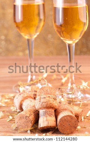 Champagne corks and gold glitter decoration - stock photo