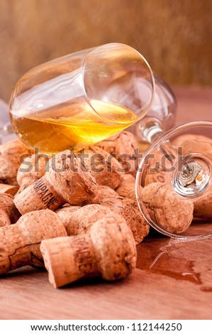 Champagne corks and spilled champagne on a wooden table - stock photo