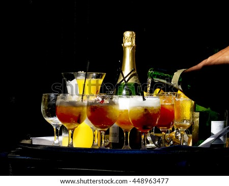 Champagne drinks being prepared at restaurant.