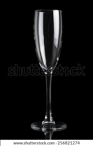 Champagne empty glass isolated on black background - stock photo