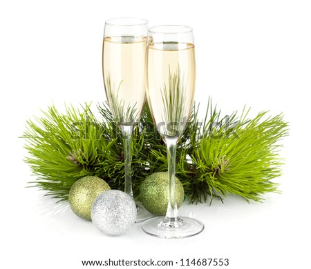 Champagne, fir tree and christmas decor. Isolated on white background