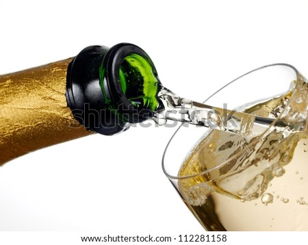 Champagne flow in a glass - stock photo