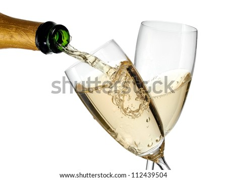 Champagne flow in two glasses - stock photo