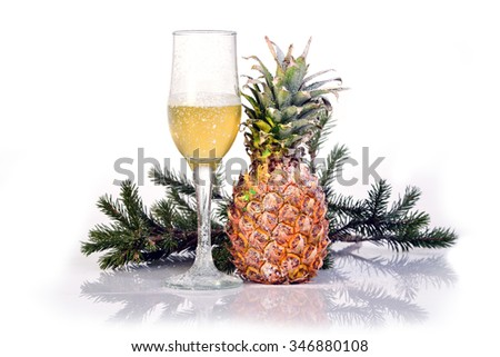 Champagne flute glass with snowy pineapple and fir-tree branch isolated on white