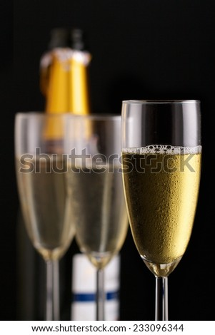 Champagne flutes and bottle - stock photo