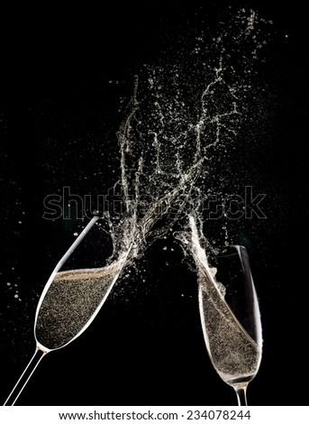 Champagne flutes on black background, celebration theme. - stock photo