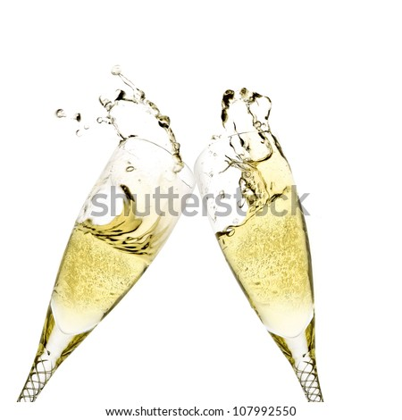 Champagne flutes toasting - stock photo
