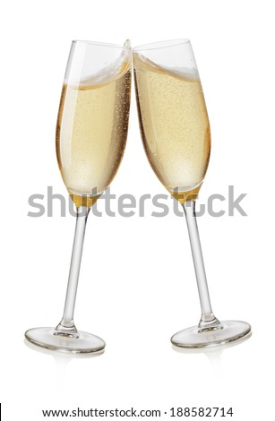 Champagne flutes toasting. Isolated on white background - stock photo