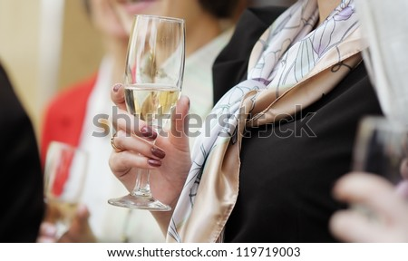 Champagne glass in woman's hand