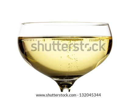 champagne glass with champagne. symbolic photo for celebrations and new year. - stock photo