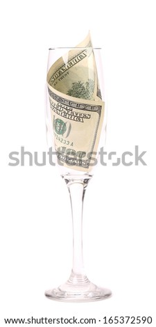 Champagne glass with money. Isolated on a white background. - stock photo