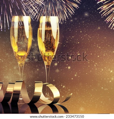 Champagne glasses and fireworks  - stock photo