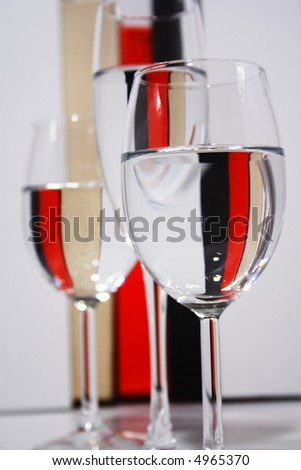 Champagne glasses detail against a color stripe background