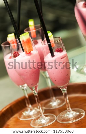 Champagne glasses filled with champagne and strawberry smoothie - stock photo