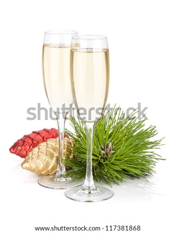 Champagne glasses, firtree and christmas decor. Isolated on white background - stock photo