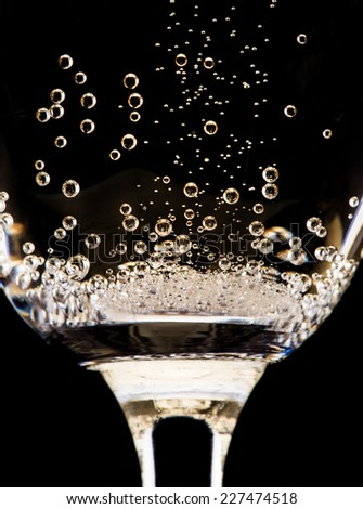 Champagne glasses isolated on black background - stock photo