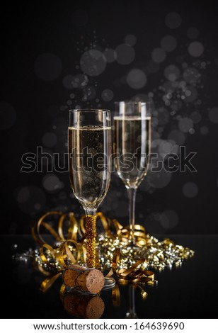 Champagne glasses on bokeh background