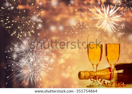 Champagne glasses on sparkling background - stock photo