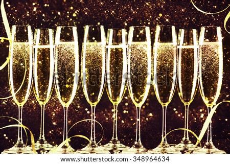 champagne glasses ready to bring in the New Year. - stock photo