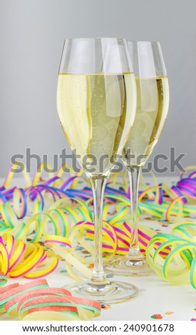 Champagne glasses, streamers and confetti /party/carnival - stock photo