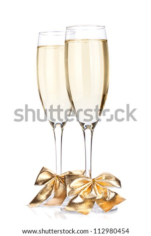 Champagne glasses with bow decor. Isolated on white background - stock photo