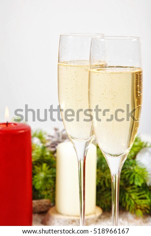 Champagne glasses with candles