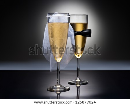 Champagne glasses with conceptual heterosexual decoration for straight couples - stock photo