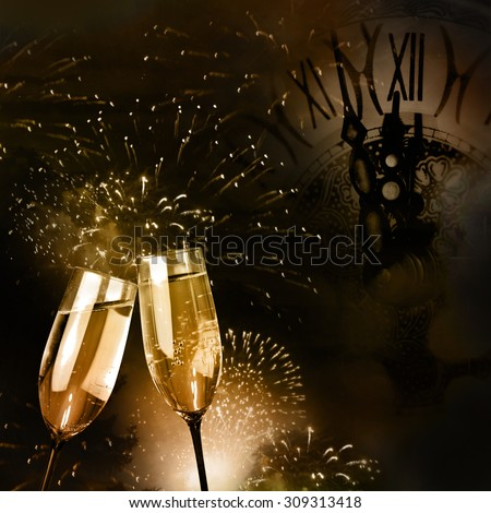 Champagne glasses with fireworks and New Year clock - stock photo